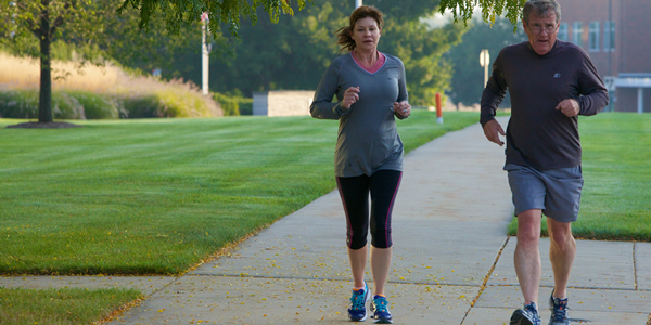 Live a Healthy Lifestyle - photo of Innovation Park residents running on path